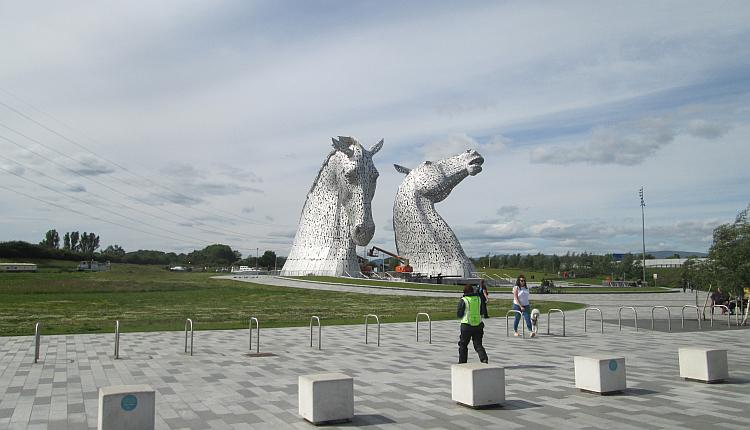 Sharon walks off to see the massive metal horse's heads at The Kelpies