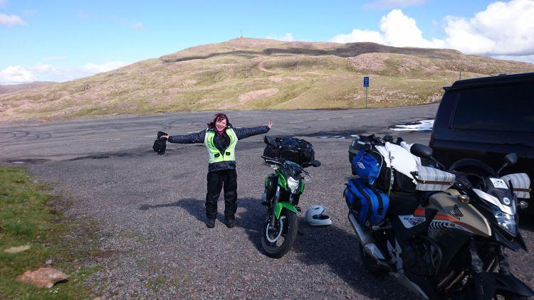 Sharon is jumping for joy having survived and conquered the Applecross Pass