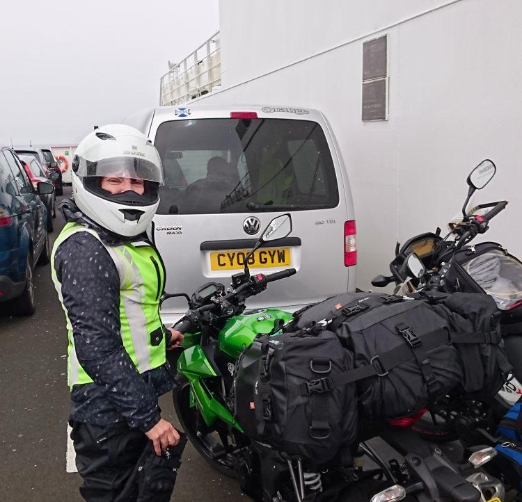 Sharon stands by her Kawasaki on the deck of the ferry across the Clyde to Durness
