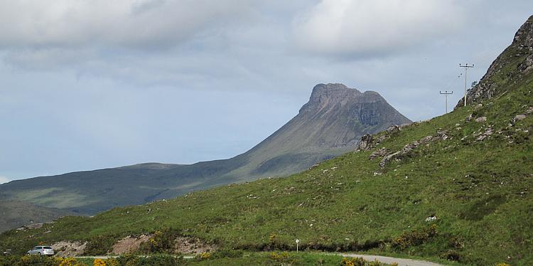 Stac Pollaidh, a mountain in the Highlands, sloping towards the top with an almost vertical outcrop at the top