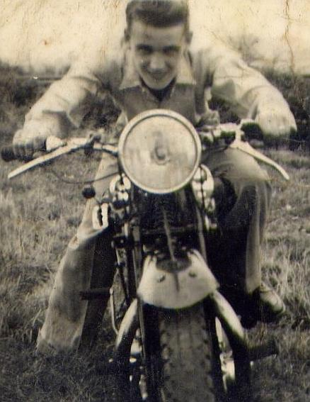 A very old image of Tom's dad grinning while looking dynamic upon a motorcycle of the day