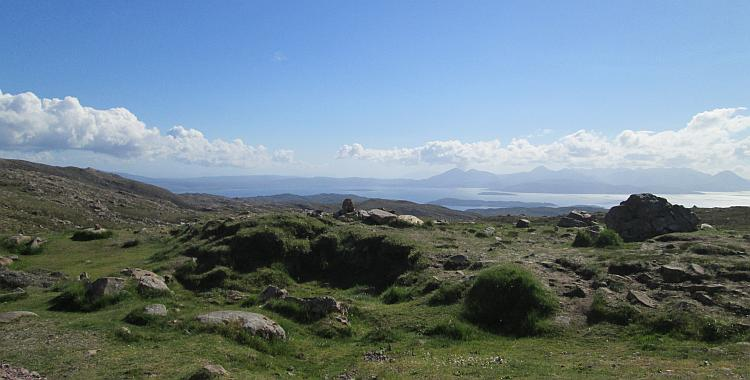 Hills, mountains, blue skies and distant rugged islands all seen from the Applecross pass