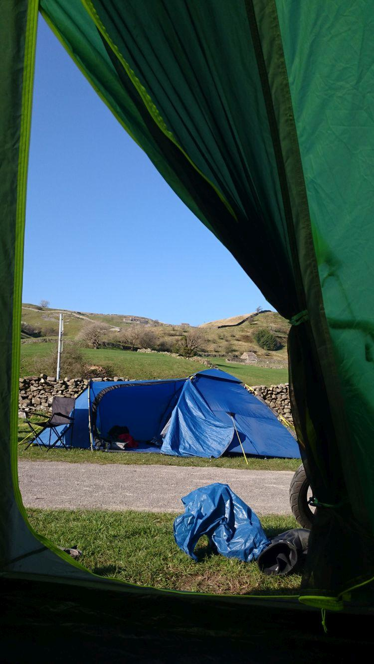 Looking out from the tent we see blue skies, another tent and the delightful Yorkshire Dales