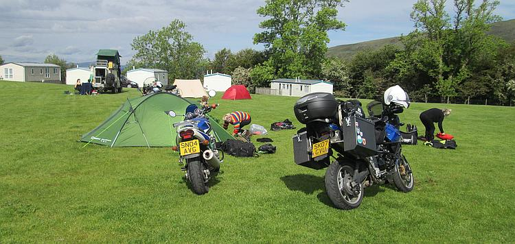 Tents and kit being stowed on motorcycles as our campers pack up ready to depart for the day
