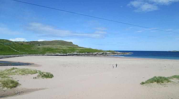 A broad beach with hills to either side at Clashnessie in Scotland