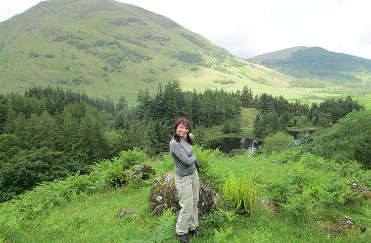 Sharon stands on the hillside showing where we think Hagrid's Hut once stood