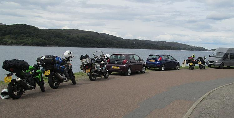 The motorcycles are at the roadside next to the Loch at Sheildaig. The skies are darker now