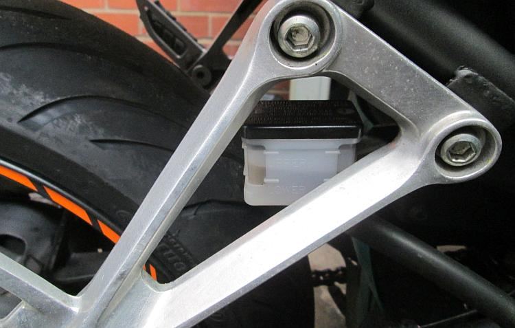 The rear master cylinder on the cb500x is behind the rear footrest