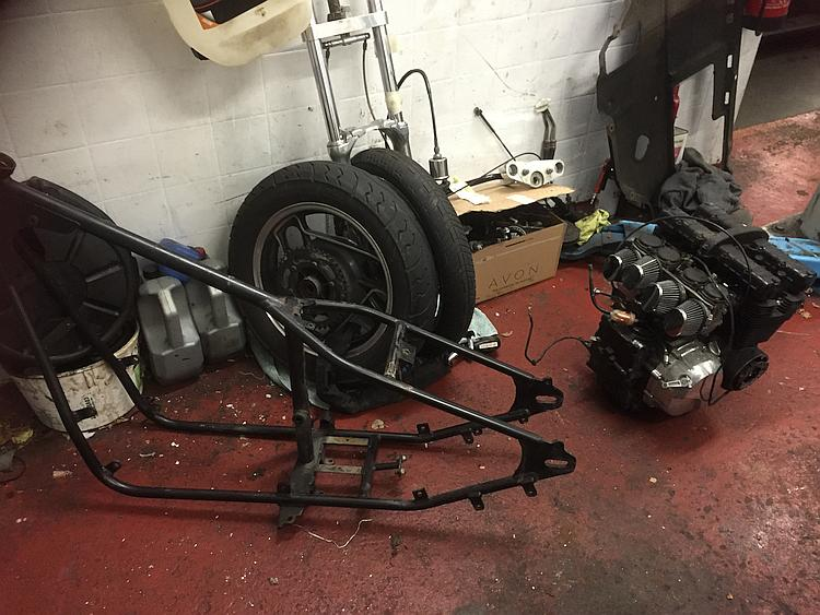 The frame, motoe, wheels and fork all stripped down in the workshop