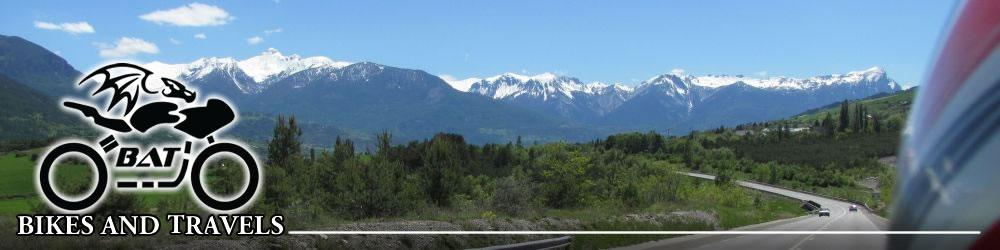 Looking across to the snow capped alpine mountains seen from the back seat of a motorcycle